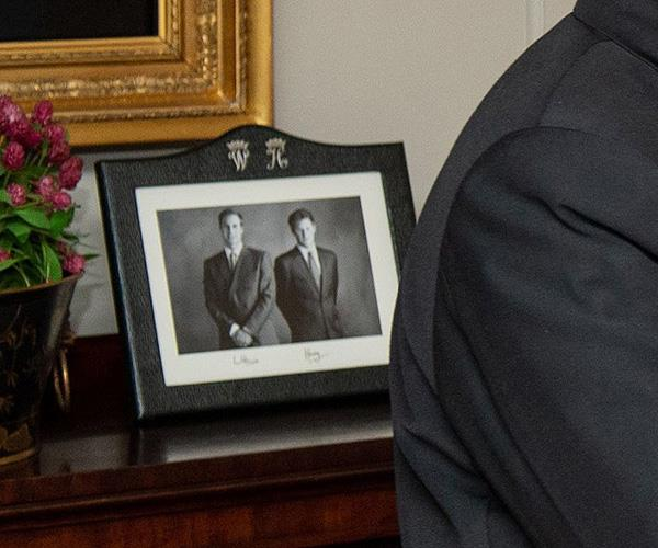 A smart black and white photo of Prince William and Prince Harry was also spotted.