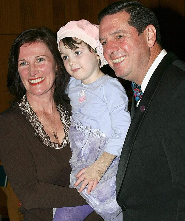 Sophie with her parents in 2005 - two years after her accident.