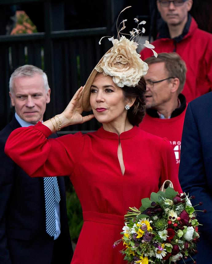 Mary rocked the hell out of this gorgeous floral headpiece in June at the celebrations of the 800 year anniversary of the Danish flag in Vordingborg, Denmark. We're filing this picture away for inspiration when the Spring Racing Carnival rolls around!