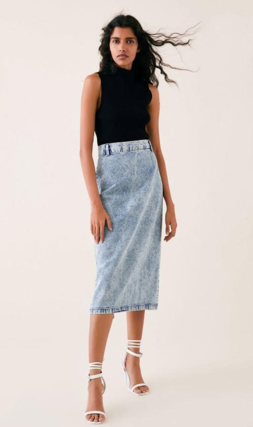 "You can casual up the royal blue midi skirt look by opting for a similar style in light denim, much like this Zara number which is available for $69.95 [here](https://www.zara.com/au/en/skirt-zw-premium-%E2%80%9880s-pencil-acid-black-p06840049.html|target=""_blank""