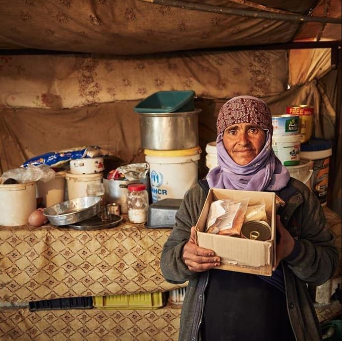 Mum Joury escaped the war in Syria six years ago. Here she stands in her kitchen in her tent home on the outskirts of Amman, Jordan.