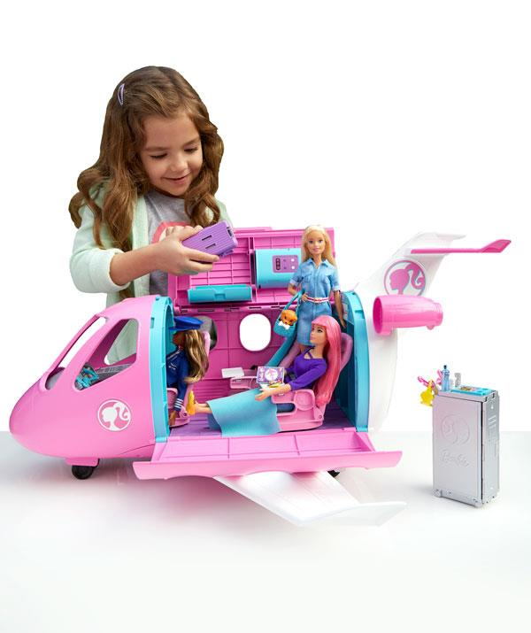 The Barbie Dream Plane takes three doll passengers - and even the seats even recline. *(Image: BIG W)*