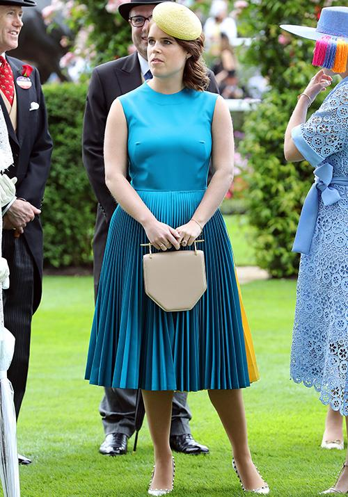 Meanwhile Princess Eugenie opted for a more vibrant shade of the go-to colour of Day 1 at Ascot - but her unexpected choice in bag colour has left fashion-enthusiasts a little stumped - perhaps colour-*un*-coordination is in?
