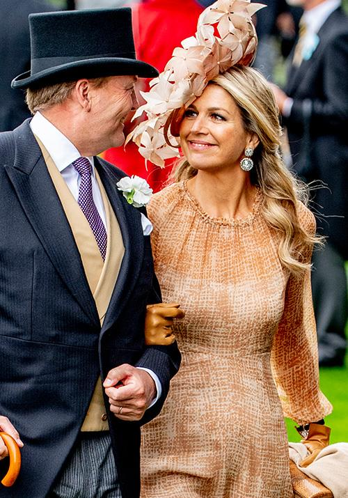She and husband King Willem-Alexander appeared to have a good time - between looks of love!