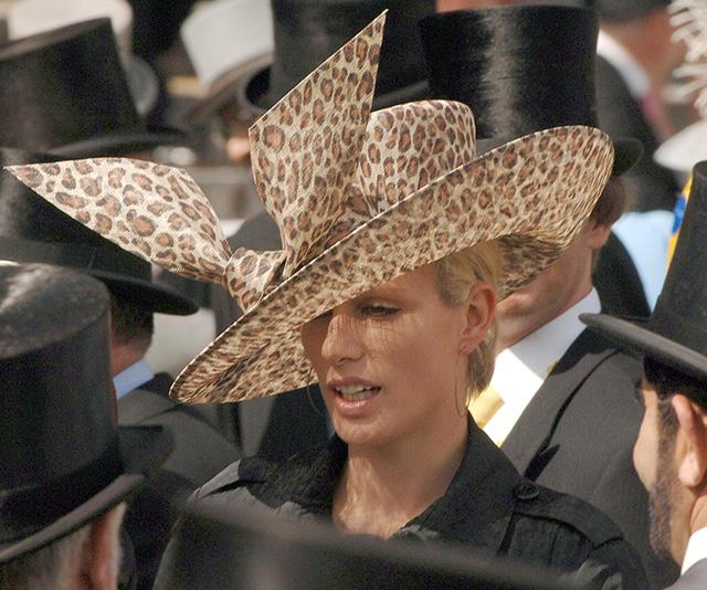 And here to remind us that the royal collection of wild hats won't be going anywhere anytime soon, we'll leave you with this leopard-print number worn by Zara in 2003. Yes it happened, no, it doesn't seem like she regretted it.