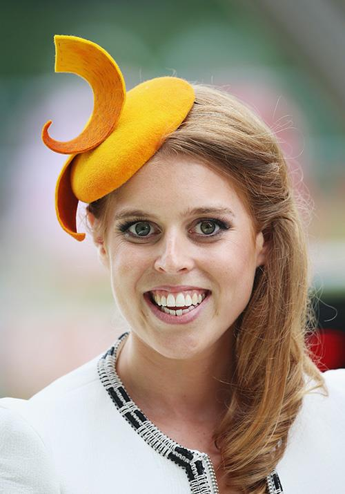 As for her sister Beatrice? Let's just say our favourite doe-eyed royal has had a plethora of hat moments that we won't forget in a hurry. This zesty orange structure she wore in 2014 has us scratching our heads...