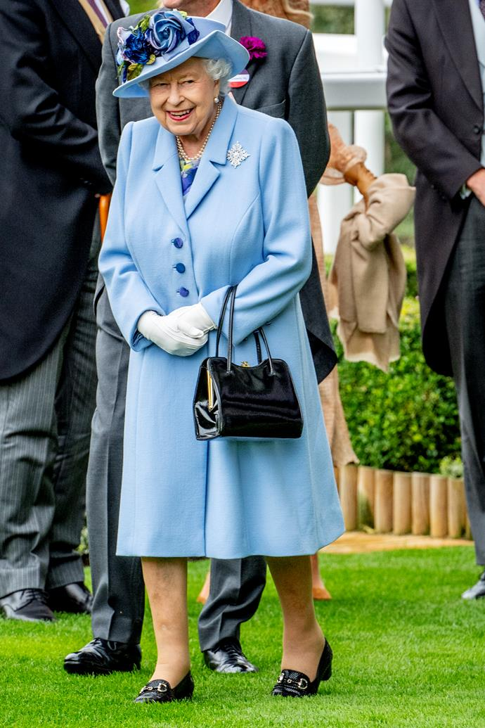 The Queen looked stunning in a bright blue ensemble for Day 1.