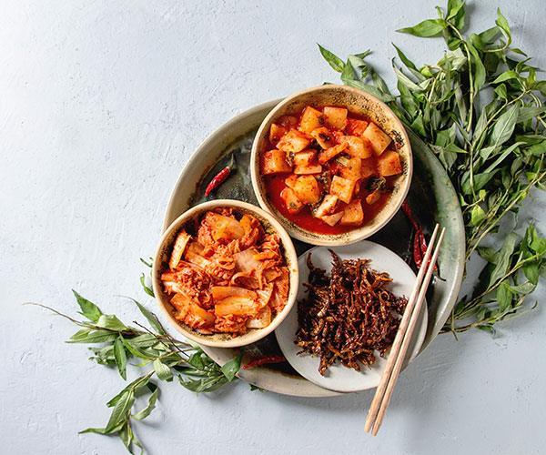 Foods like kimchi, yoghurt, sauerkraut, and miso are high in probiotics.