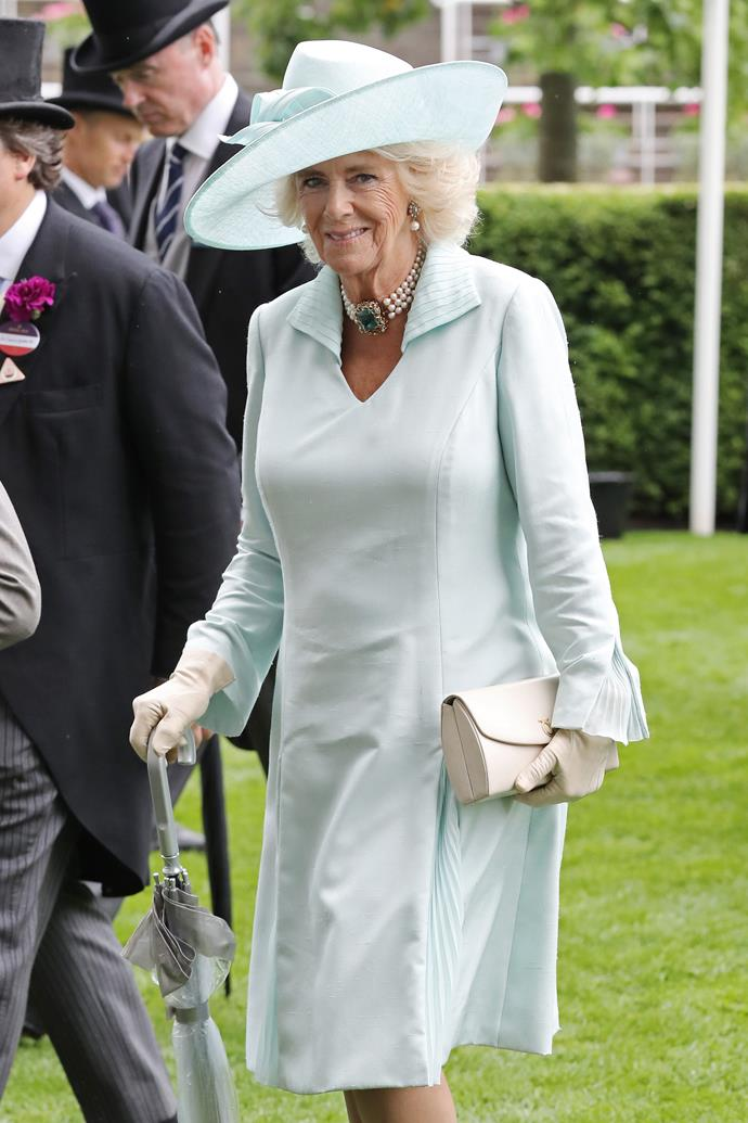 On day two of the frivolous event, Duchess Camilla stunned in Tiffany blue as she stepped out on the Ascot green. We can't get enough of this pear choker necklace either - that turquoise jewel!