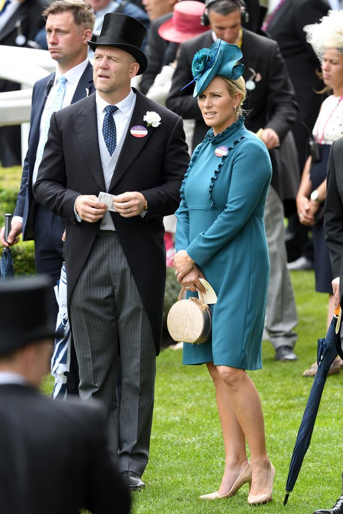 "Zara tested the royal racing rule book when she wore this teal coloured dress that fell *just* above her knees... but did she [actually break protocol](https://www.nowtolove.com.au/fashion/fashion-news/zara-tindall-royal-ascot-56541|target=""_blank"")? You decide!"