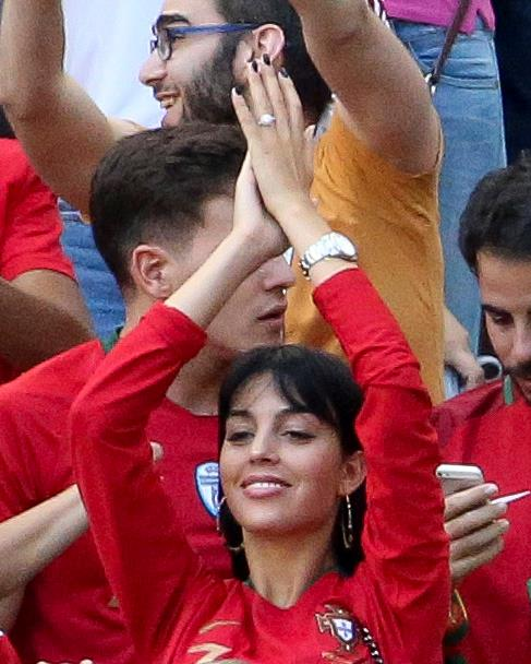 Cheering on her man at the World Cup - and check out that rock!