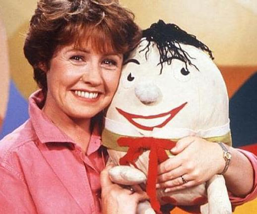 A young Noni pictured with Humpty Dumpty, one of Play School's recurring characters.