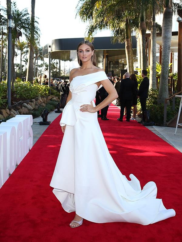 *E!* host and model Ksenija Lukich looks jaw-dropping in this striking white gown.