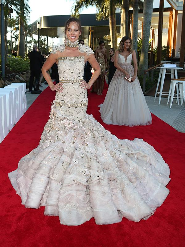 "Seriously, how stunning is Bonnie Anderson's dress?! ""It took me a couple of hours. ""To get into this, it was pretty quick but it took a few people to get me in it – three,"" she told TV WEEK on the red carpet. ""It's been a real fun process because this dress was made and it took about 25 days to make and it's been really special watching it all come together and it was made by Viviana Lorikeet."""