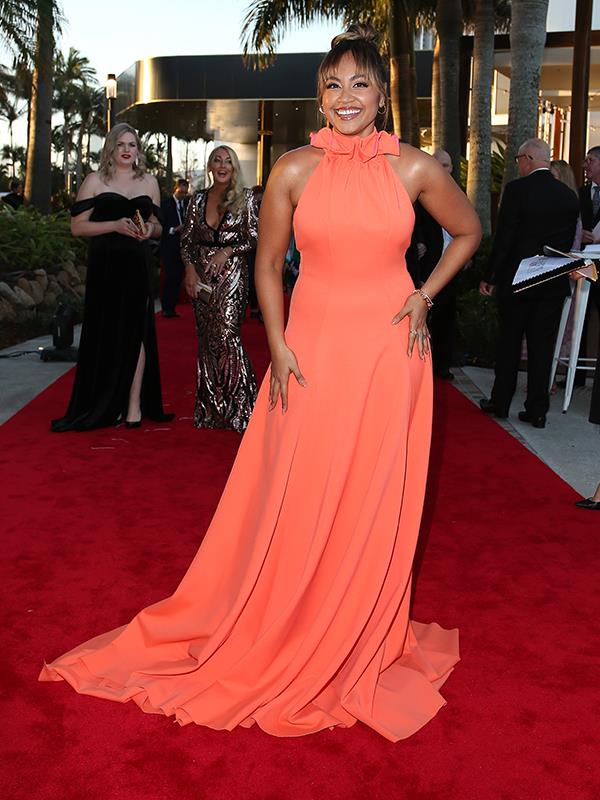 Jessica Mauboy brings a zesty pop of colour to the red carpet in this orange number.