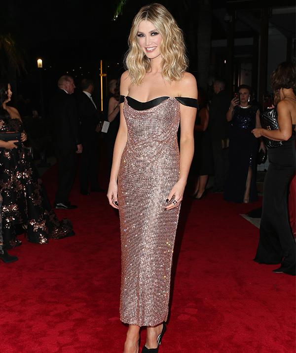 Aussie darling Delta Goodrem looks *so* chic in this sparkly number. In fact, she makes a strong case for best dressed of the whole night!