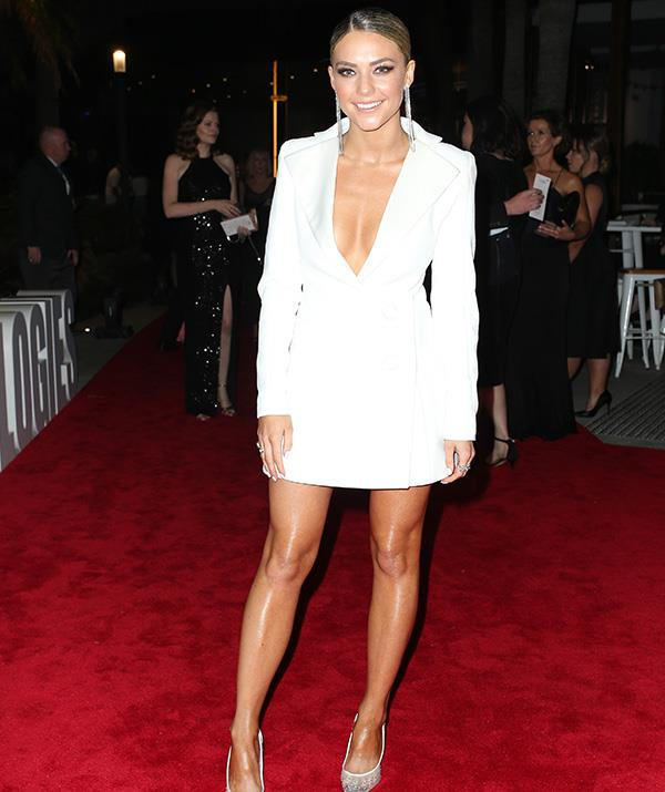 Sam Frost swapped her usual beachwear for a white tuxedo style dress.