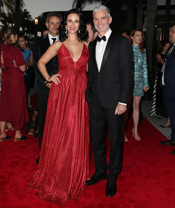 Lucy Zelic and Craig Foster are all smiles. We're loving Lucy's gorgeous red gown!