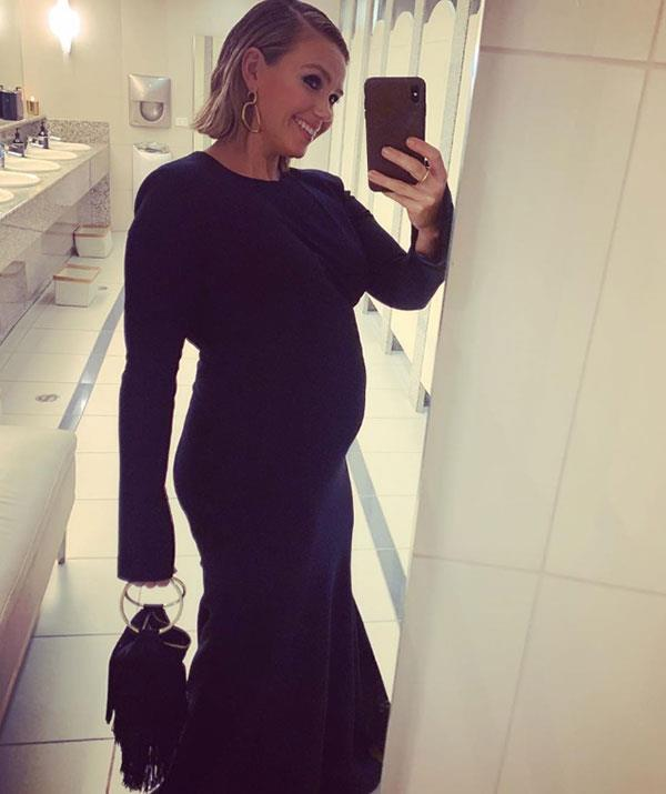 """Edwina Bartholomew announced her pregnancy on *Sunrise* in June. Just weeks later she attended the TV WEEK Logies in a stunning Rebecca Vallance gown that accentuated her gorgeous growing baby bump. """"I didn't get a picture on the red carpet so here is one in the loo,"""" she captioned the snap on Instagram."""