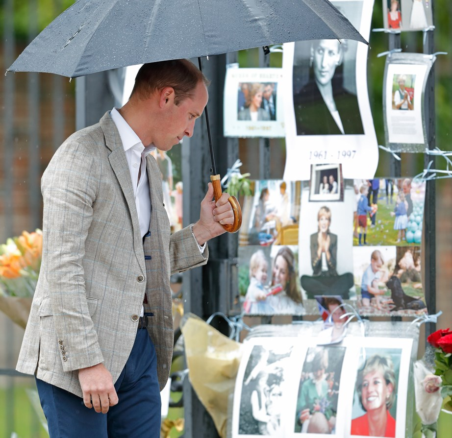 This image and the one below show Prince William and Prince Harry joining fans who held a vigil for their late mother, Princess Diana, in 2017.