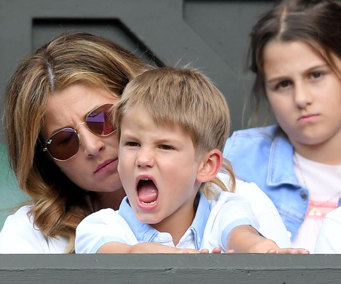 One of the twins is comforted by his mother, Mirka.