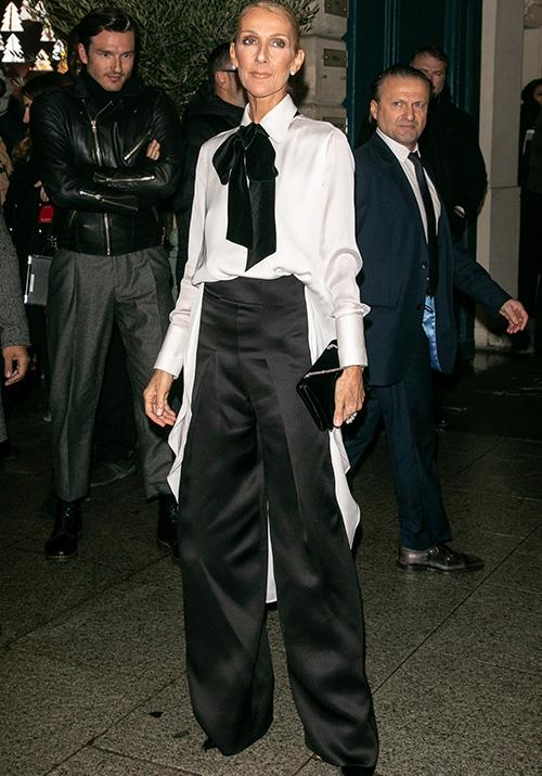 For Armani, Dion opted for a masculine pant and shirt combo - and that black bow added just the right amount of oomph.