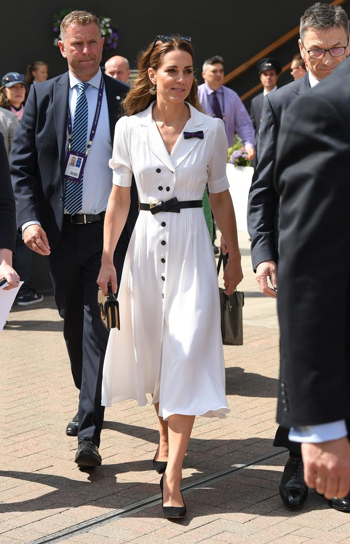 """In a moment that left us fashion-fantatics giddy with glee, [Kate Middleton's 2019 Wimbledon appearance](https://www.nowtolove.com.au/royals/british-royal-family/kate-middleton-wimbledon-2019-56799 target=""""_blank"""") on day two featured a rather apt nod to the talented players on the court. Always one to follow the royal rule book, Kate's white shirt dress was well aligned with the infamous on-court dress code."""