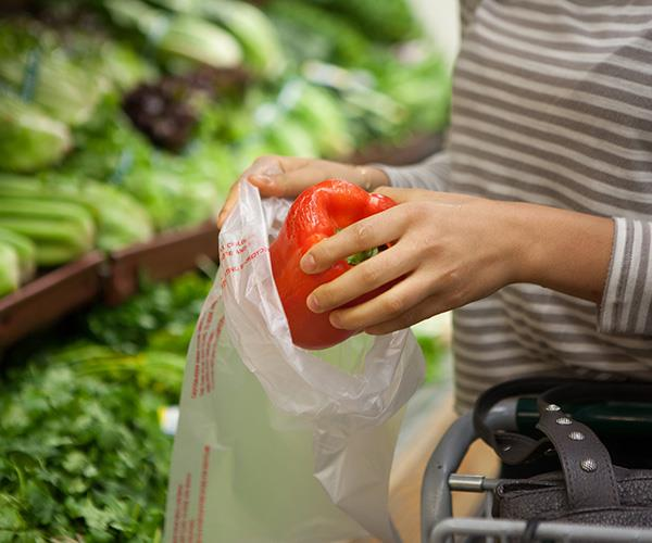 Ditch the small plastic bags and bring your own or just chuck them in the trolley.