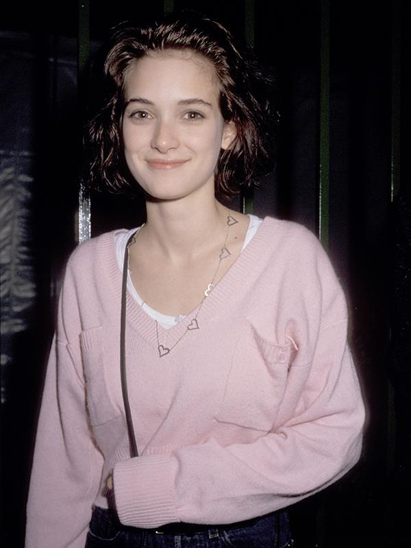 Winona in a simpler time when you could wear a pink jumper to a Grammys after party.