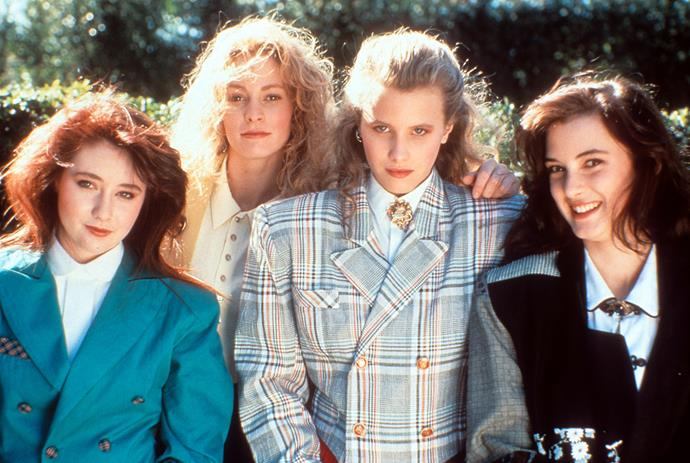 A fresh-faced Winona (far right) was one of the leads in cult classic *Heathers*.