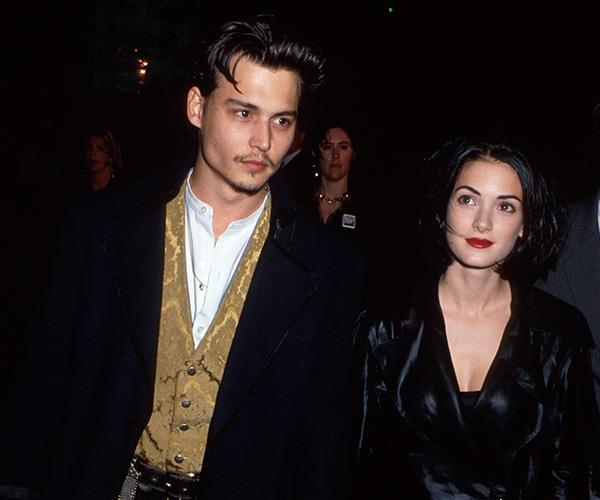 We're not sure what we love more, Winona's bold red lip or her iconic ex, Johnny Depp.
