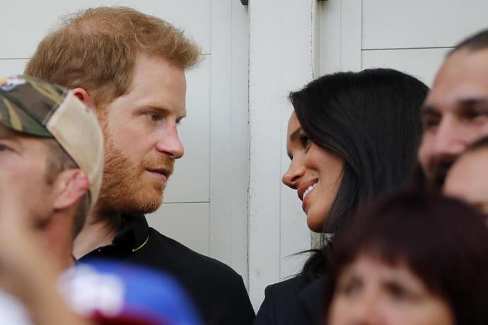 Meghan and Harry were seen watching the game in the stands (between adoring looks at one another!).