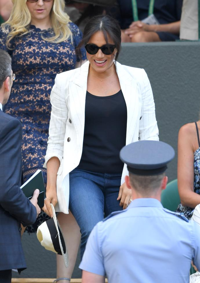 Meghan made a dazzling surprise appearance at Wimbledon.