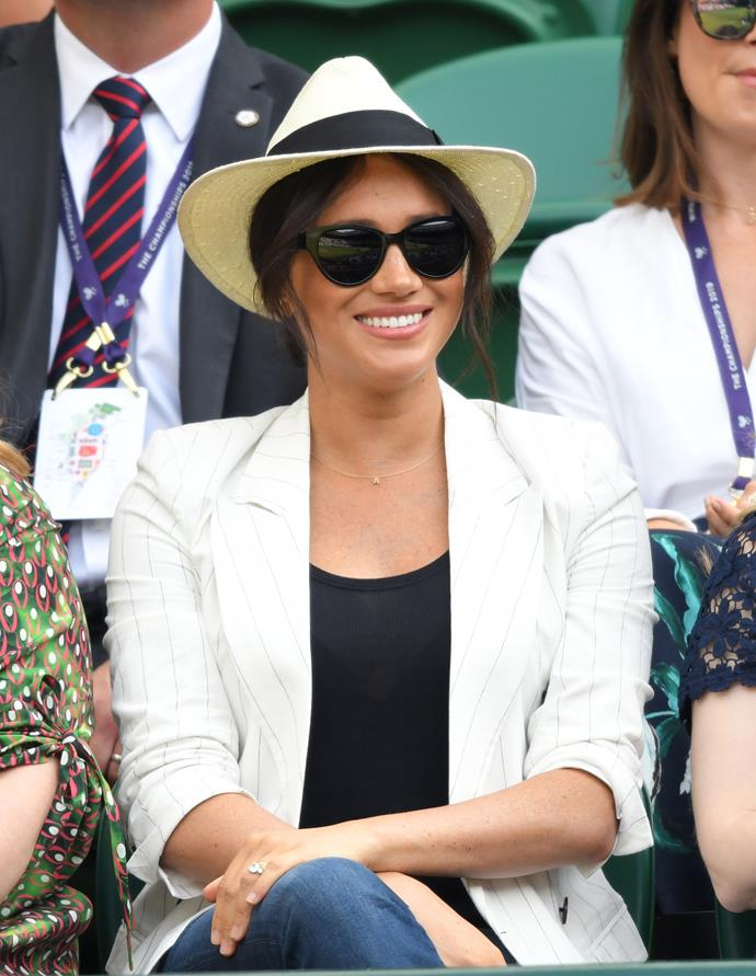 The Duchess was all smiles as she sat in the stands.
