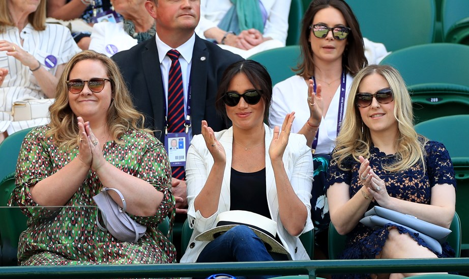 Meghan attended her good pal Serena Williams' second-round match at Wimbledon accompanied by two of her longtime friends Lyndsay and Genevieve, who will attend Archie's christening this weekend. *(Image: Getty)*