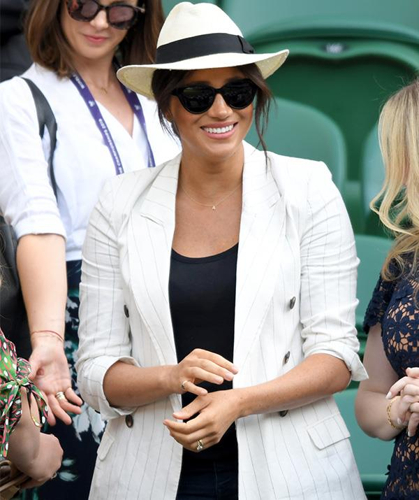 Meghan was glowing at Wimbledon on Thursday.