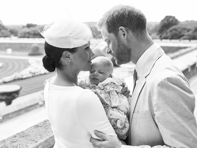 The second photo features the Sussex trio sharing an intimate moment in the grounds of Windsor Castle.