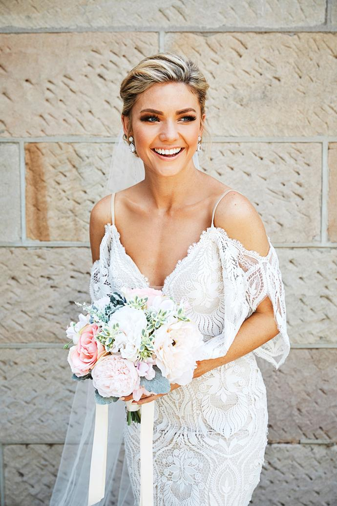 Jasmine looks incredible in a white lace gown on her wedding day.