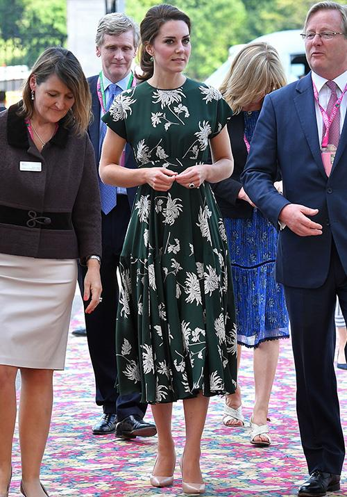 Months apart, the Duchess opted for another green printed dress at the Chelsea Flower Show. Designed by Rochas, the classic silhouette was a timeless style.