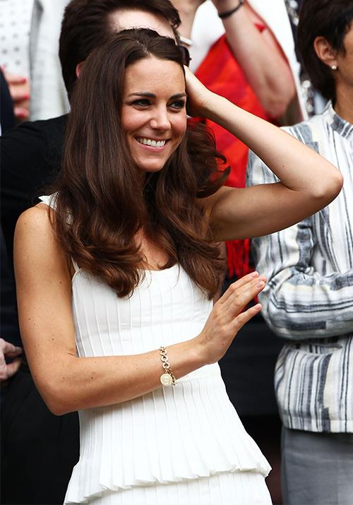 Paring it with a simple gold chain bracelet, we'll safely say Kate took out the game, set and match in this ensemble.