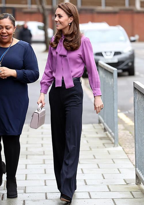 Kate opted to wear this gorgeous Gucci blouse backwards in March 2019.