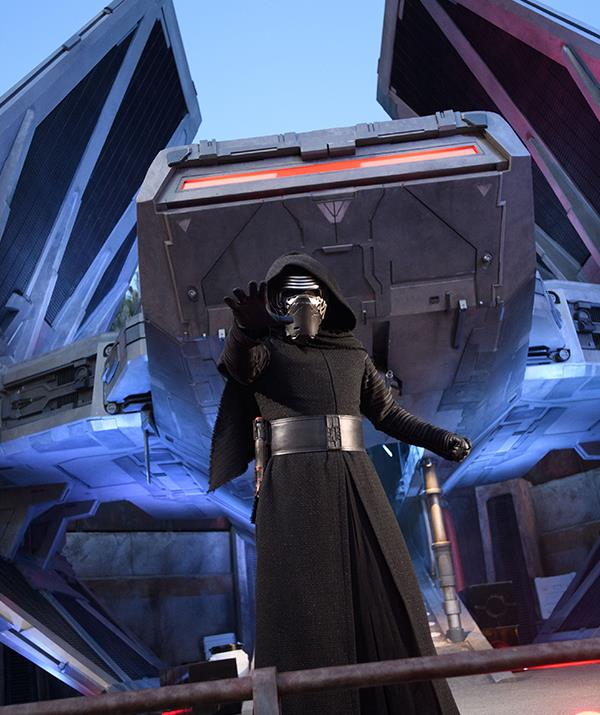 Kylo Ren menaces residents of Black Spire Outpost at *Star Wars*: Galaxy's Edge.