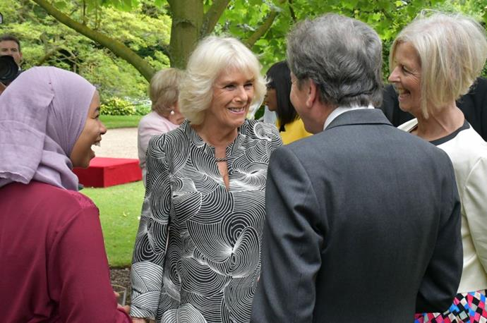 Camilla looked gorgeous in a bright retro-print dress.
