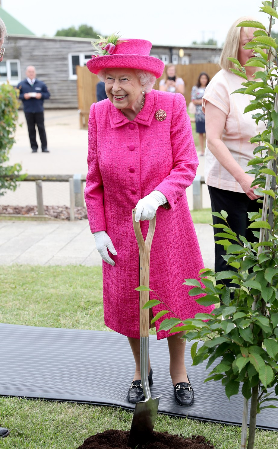 The Queen earlier this week, planting a tree in Cambridge. *(Image: Getty)*