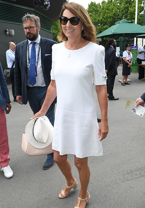 Meanwhile, the ultimate family muse Carole Middleton absolutely nailed tennis-chic in this fresh white t-shirt dress with strappy beige heels.