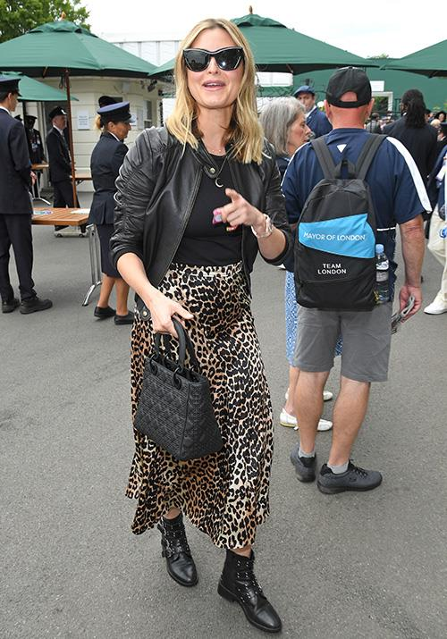 Aussie singer Holly Valance rocked an animal print for her big day out at the tournament. This biker-chic get-up gets a nod of approval from us!