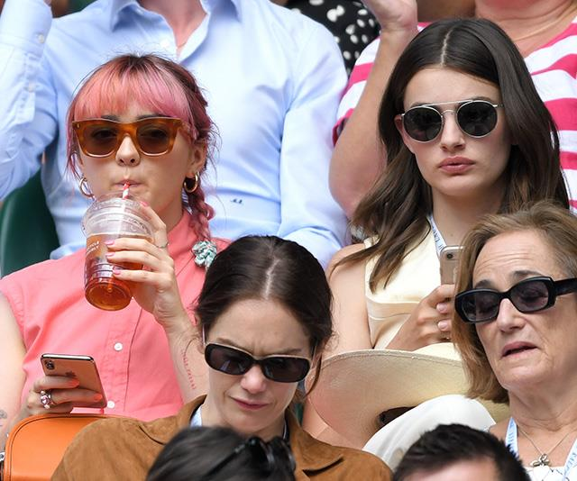 *Game of Thrones* star Maisie Williams and *Booksmart* actress Diana Silvers looked enthralled with the game unfolding before them.