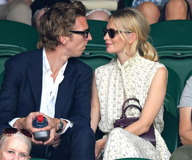Model Poppy Delevingne and husband James Cook had eyes only for each other, despite an exciting match unfolding before them.