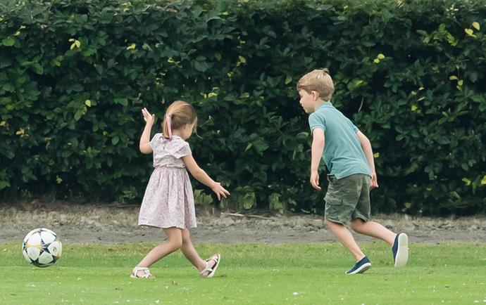Team Cambridge! Charlotte and George looked to be having the time of their lives as they kicked a ball around.