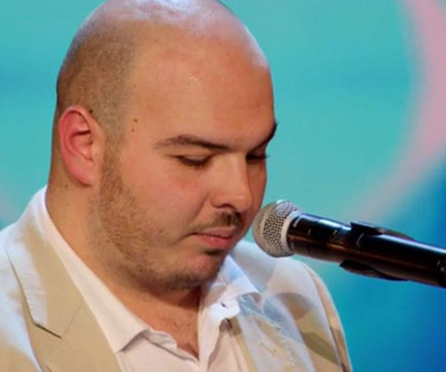 Blind contestant Paul performs on stage to a standing ovation